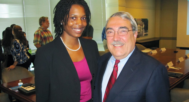 Jasmine Colquitt, dual NCCU MBA/JD student and Kenan Institute intern with Congressman G.K. Butterfield after the final presentations