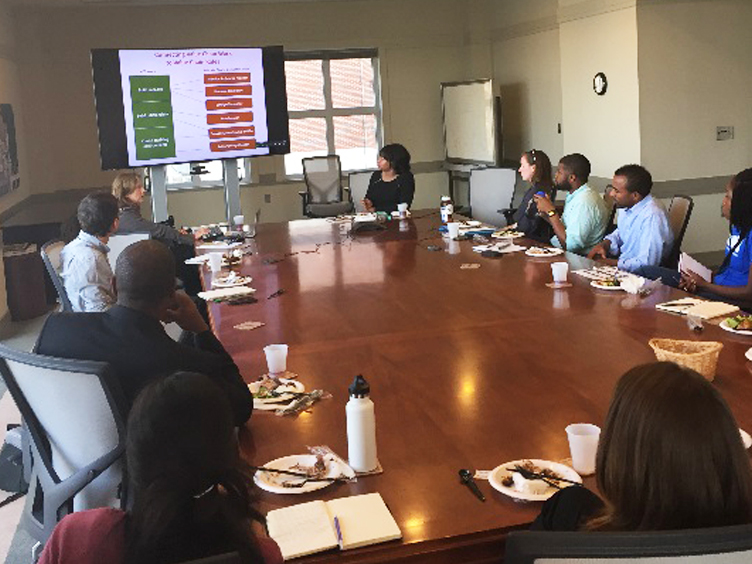 NCGrowth advisory boar dmember Rebecca Dunning presents her research to NCGrowth analysts.