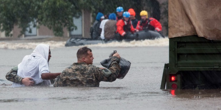 North Carolina Army National Guardsmen (NCNG) and local emergency services assist with the evacuation efforts in Fayetteville, N.C., on Friday, Oct. 08, 2016. Heavy rains caused by Hurricane Matthew have led to flooding as high as five feet in some areas. U.S. Army National Guard photo by Staff Sgt. Jonathan Shaw, 382nd Public Affairs Detachment/Released.